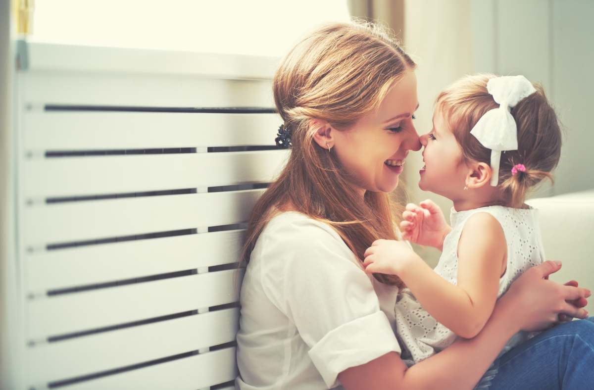 Mother and daughter playfully rubbing noses